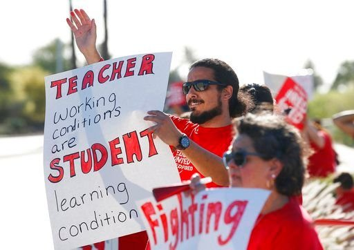 Arizona Education Association president Joe Thomas said that tomorrow's march to the Capitol is necessary after attempts at outreach have been ignored. (Source: AP Photo)