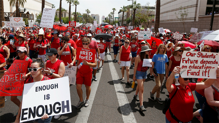 Thousands march in the street to the Arizona Capitol for higher teacher pay and school funding Thursday, April 26, 2018, in Phoenix. (Source: AP Photo/Ross D. Franklin)