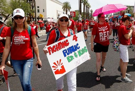 Thousands march to the Arizona Capitol for higher teacher pay and public school funding on the first day of a state-wide teachers strike Thursday, April 26, 2018, in Phoenix. (Source: AP Photo)