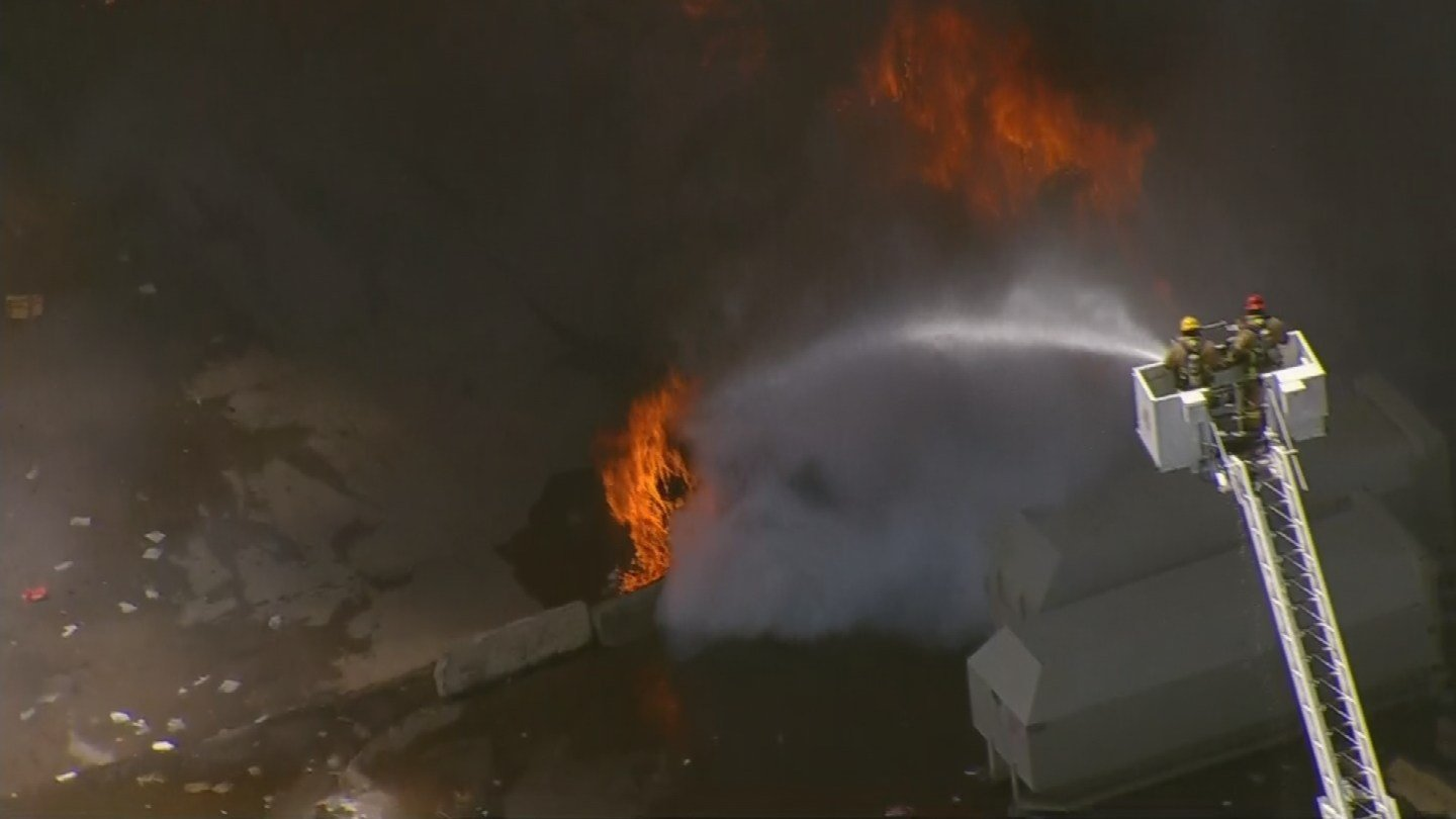 Ladder trucks poured water on the burning material from multiple locations. (Source: 3TV/CBS 5 News)