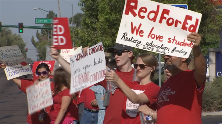 Teachers and supporters line a Phoenix street for continued support of the RedForEd movement one day after Gov. Ducey said a deal was reached for teacher pay. (Source: 3TV/CBS 5)