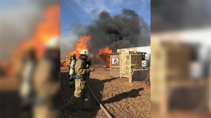 There are some large machinery as well as some pallets that are also involved in the fire, fire crews said. (Source: Phoenix Fire Department)