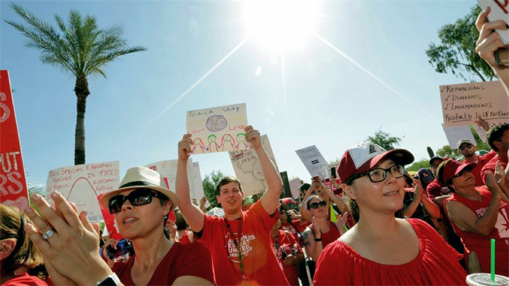 FILE - In this April 27, 2018 file photo, teachers rally outside the Capitol in Phoenix, in a series of strikes across the nation over low teacher pay. (AP Photo/Matt York, File)
