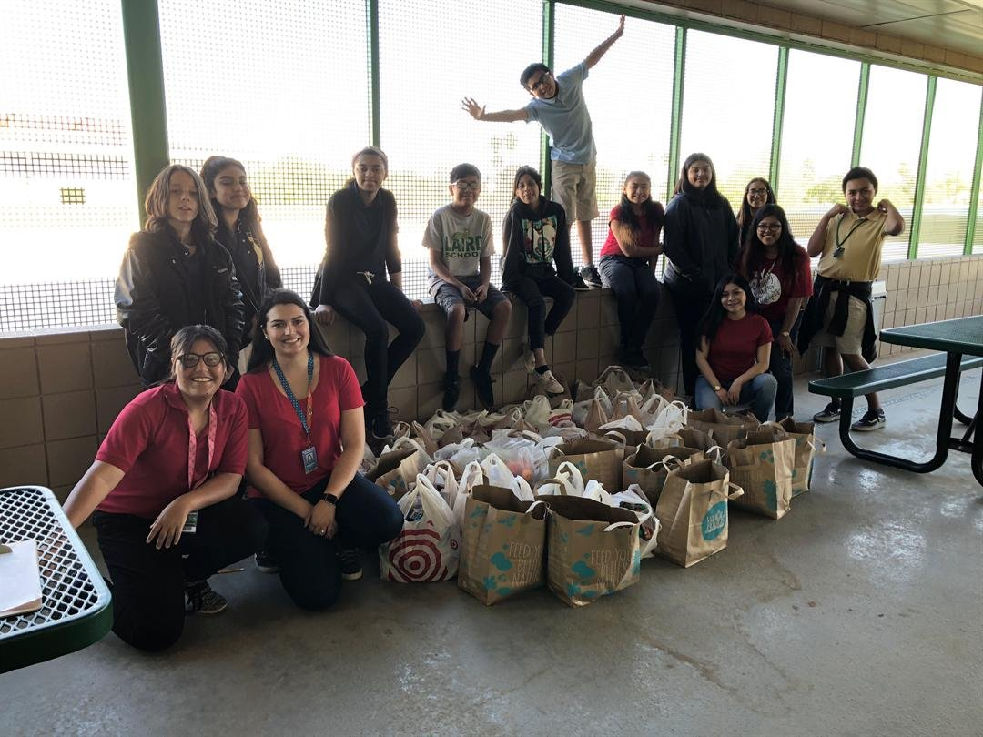 Students helped put the food bags together. (Source: Jessica Monroe)