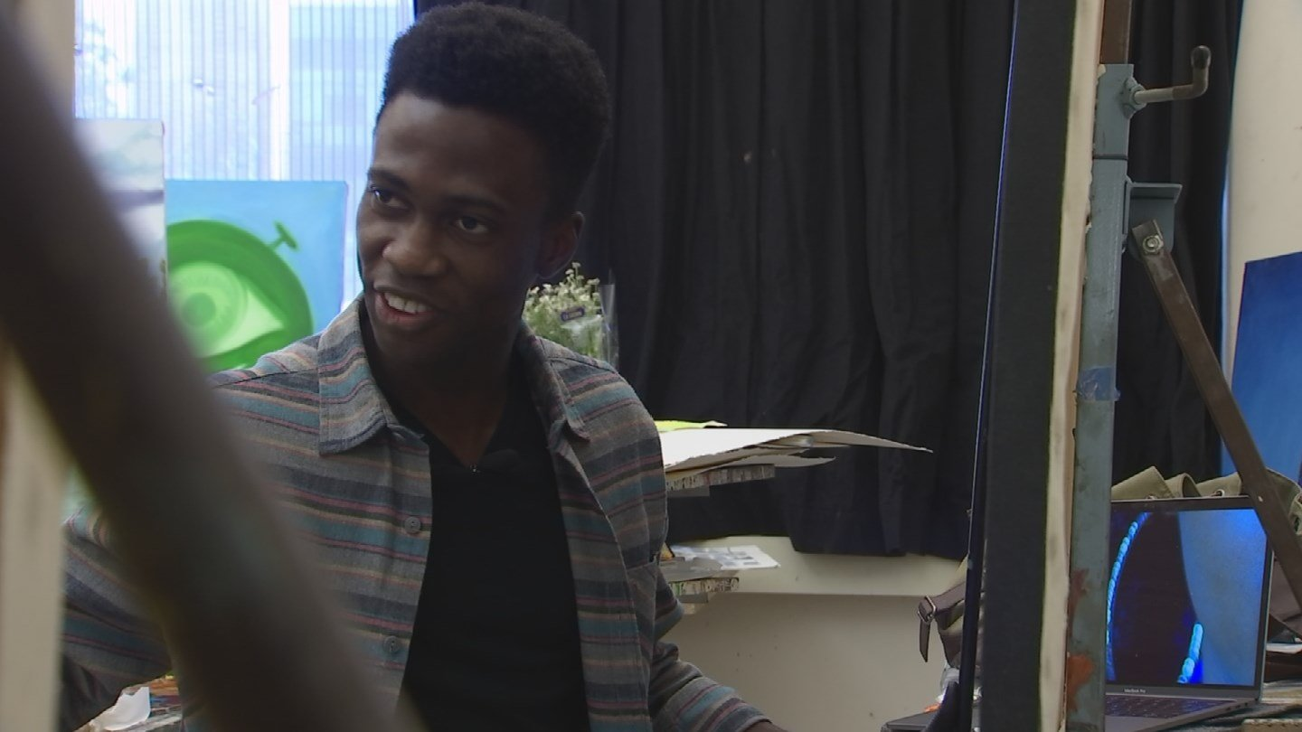 Papay Solomon, 24, is an artist whose paintings of African refugees are gaining notority. (Source: 3TV/CBS 5 News)