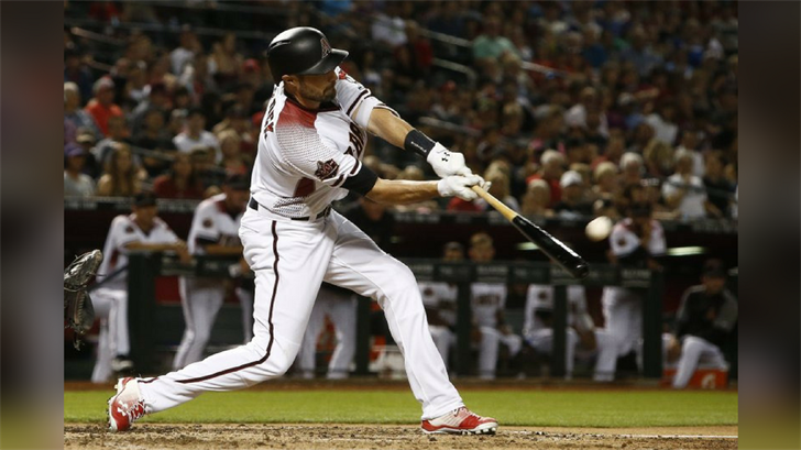 Arizona Diamondbacks' A.J. Pollock connects for a home run, his second of the night, during the fifth inning of a baseball game against the Los Angeles Dodgers Monday, April 30, 2018, in Phoenix. (Source: AP Photo/Ross D. Franklin)