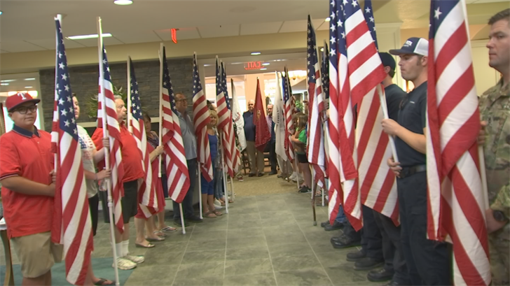Dozens of young people from Youth for Troops, a volunteer organization dedicated to supporting veterans and military members, showed up holding about 30 American flags. (Source: 3TV/CBS 5)