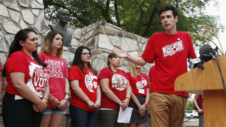 Teacher Noah Karvelis, right, speaks during a news conference prior to protest organizers announcing their intention to go back to work as the statewide teachers strike enters a fourth day at the Arizona Capitol. (Source: AP Photo/Ross D. Franklin)