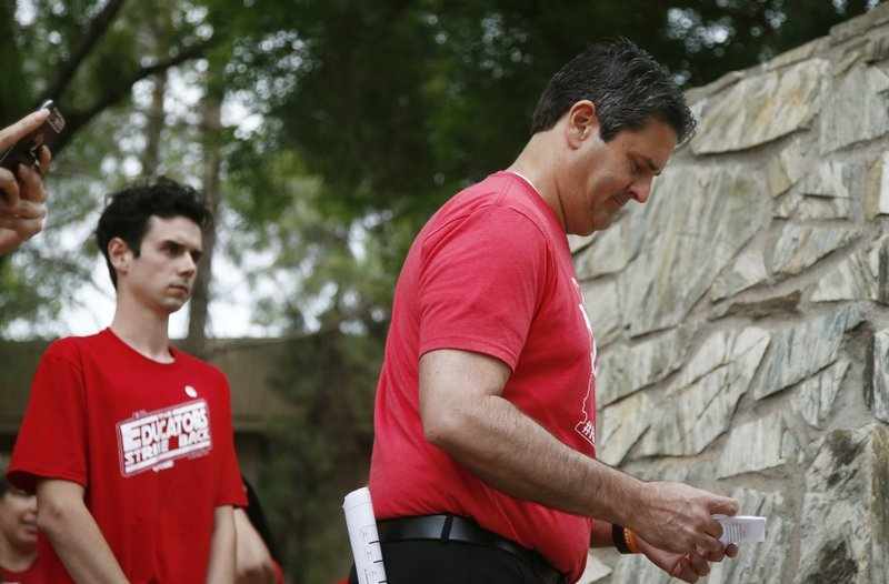 Teacher protest organizers Joe Thomas, right, president of the Arizona Education Association, and Noah Karvelis, left, who helped organize Arizona Educators United, arrive at a news conference. (Source: AP Photo/Ross D. Franklin)