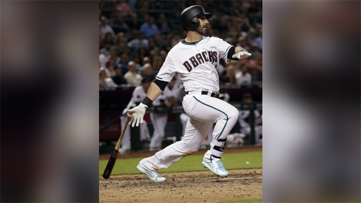 Arizona Diamondbacks' Daniel Descalso follows through on a two-run triple against the Los Angeles Dodgers during the seventh inning of a baseball game Tuesday, May 1, 2018, in Phoenix. (Source: AP Photo/Matt York)