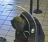 The suspect was also wearing a black jacket, black gloves, black pants and black shoes. (Source: FBI)