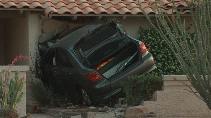 Police said a suspected impaired driver crashed into a house. (Source: 3TV/CBS 5)