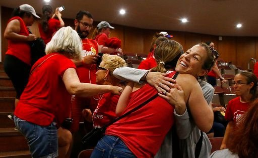 The education funding plan approved by lawmakers shortly before dawn was immediately signed by Gov. Doug Ducey, awarding teachers a 9 percent raise in the fall and 5 percent in each of the next two years. (Source: AP Photo)