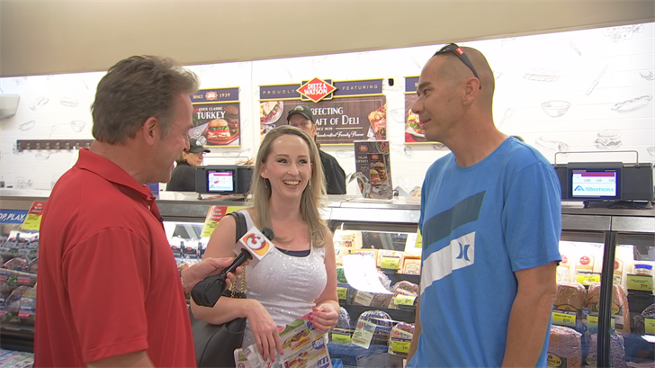 Customers at a Phoenix-area Albertson's got surprised when 3TV anchor Scott Pasmore offered to pay for their groceries. (Source: 3TV/CBS 5)