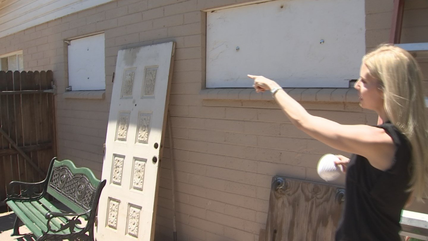 Katie Rubin points out damage to her parents home. (Source: 3TV/CBS 5 News)