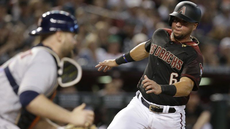 Arizona Diamondbacks David Peralta scores a run in front of Houston Astros catcher Brian McCann on a sacrifice fly by A.J. Pollock during the first inning of a baseball game Saturday, May 5, 2018, in Phoenix. (Source: AP Photo/Rick Scuteri)