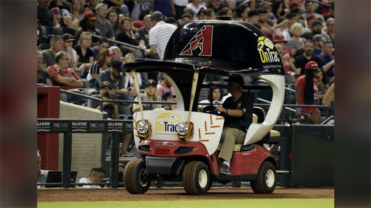 The Arizona Diamondbacks' bullpen cart is driven on the warning track during the eighth inning of the team's baseball game against the Houston Astros, Saturday, May 5, 2018, in Phoenix. (Source: AP Photo/Rick Scuteri)