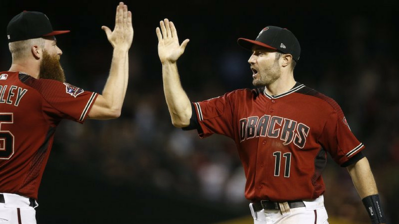 Arizona Diamondbacks center fielder A.J. Pollock (11) celebrates with relief pitcher Archie Bradley, left, after the final out of a baseball game against the Houston Astros, Sunday, May 6, 2018, in Phoenix. (Source: AP Photo/Ross D. Franklin)