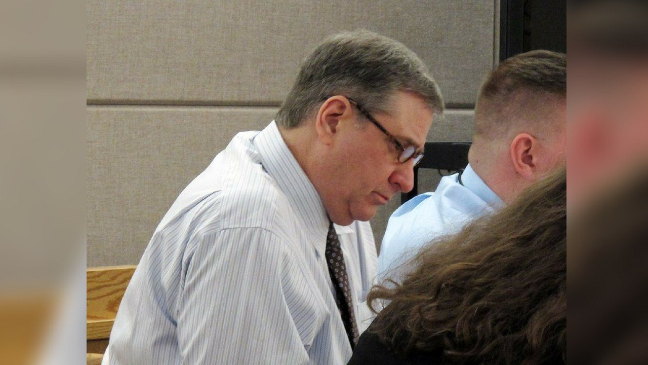 Mark Desimone, a former Arizona legislator charged with killing a man on an Alaska hunting and fishing trip in 2016, looks over documents during his trial in Juneau, Alaska, Thursday, May 10, 2018. (AP Photo/Becky Bohrer)