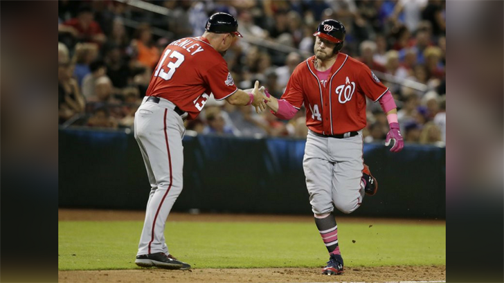 Washington Nationals Mark Raynolds (14) celebrates with Bob Henley after hitting a two run home run against the Arizona Diamondbacks in the eighth inning during a baseball game, Sunday, May 13, 2018, in Phoenix. (Source: AP Photo/Rick Scuteri)
