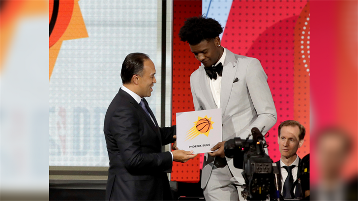 NBA Deputy Commissioner Mark Tatum, left, congratulates Phoenix Suns forward Josh Jackson after Tatum announced that the Suns had won the first pick for the NBA basketball draft. (Source: AP Photo/Charles Rex Arbogast)