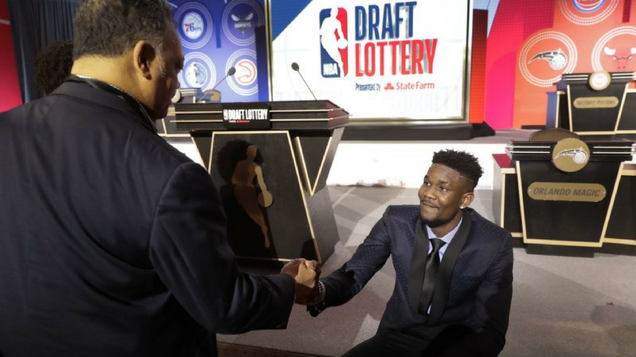 Arizona's Deandre Ayton, right, shakes hands with the Rev, Jesse Jackson before the NBA basketball draft lottery Tuesday, May 15, 2018, in Chicago. (Source: AP Photo/Charles Rex Arbogast)