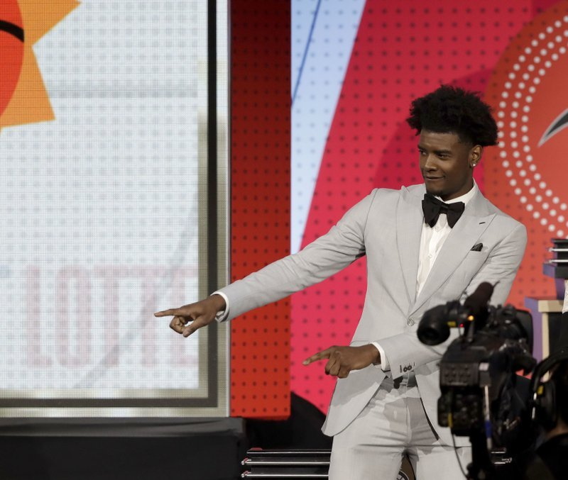 Phoenix Suns forward Josh Jackson reacts after the team won the first pick of the 2018 NBA Draft during the NBA basketball draft lottery Tuesday, May 15, 2018, in Chicago. (Source: AP Photo/Charles Rex Arbogast)