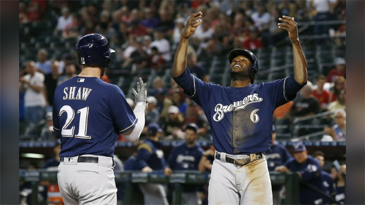 Milwaukee Brewers' Travis Shaw (21) celebrates his two-run home run against the Arizona Diamondbacks with teammate Lorenzo Cain (6) during the first inning of a baseball game Wednesday, May 16, 2018, in Phoenix. (Source: AP Photo/Ross D. Franklin)