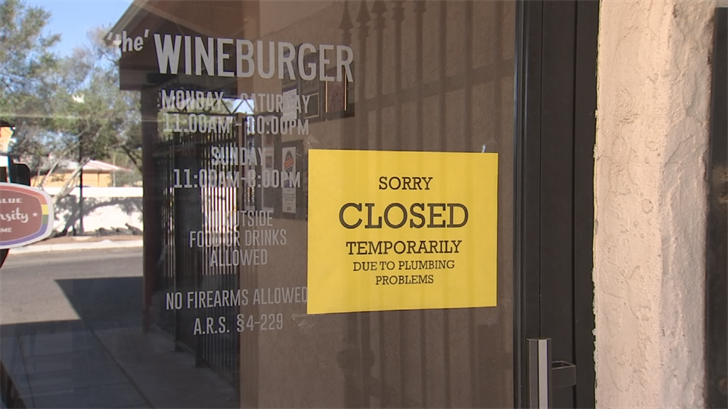 The sign on the door says the business is only closed temporarily due to plumbing problems. (Source: 3TV/CBS 5)