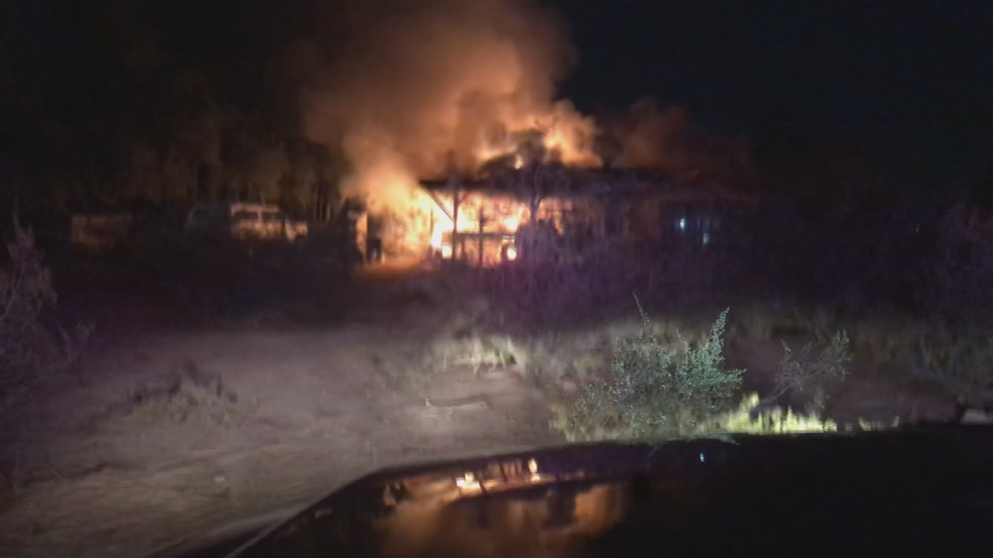 Flames spread to a shed that had ammunition in it and they started going off. (Source: Phoenix Fire Department)
