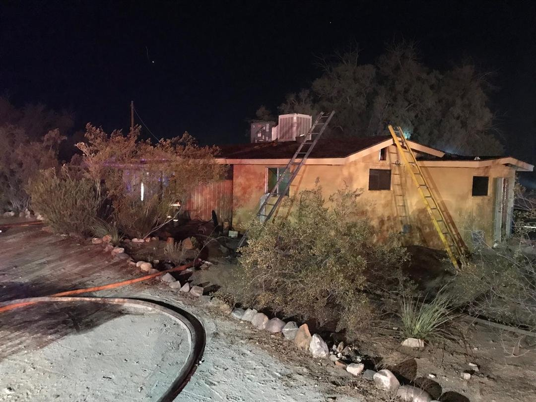 The flames started in the backyard and spread to the shed and the house. (Source: Phoenix Fire Department)