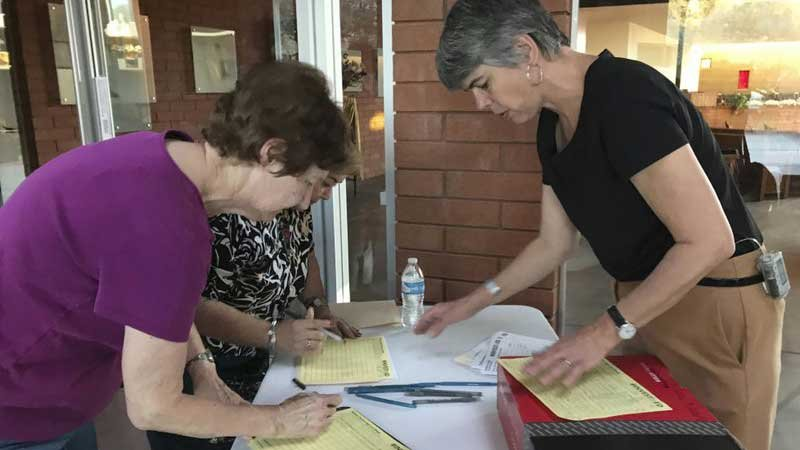 None Melanie Beikman, right, Thousands of teachers in Arizona, gathers signatures Thursday, May 10, 2018 in Phoenix for a ballot initiate to raise the income tax on wealthy earners to fund public education. (Source: Melissa Daniels, AP)