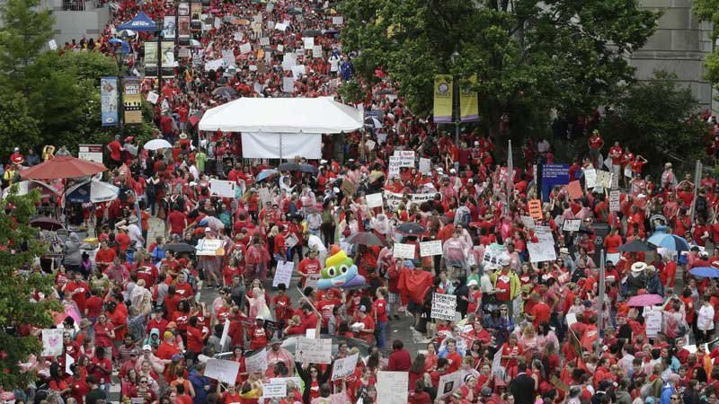 Educators filled Bicentennial Plaza during a teachers rally at the General Assembly in Raleigh, N.C., Wednesday, May 16, 2018. (Source: Gerry Broome, AP)