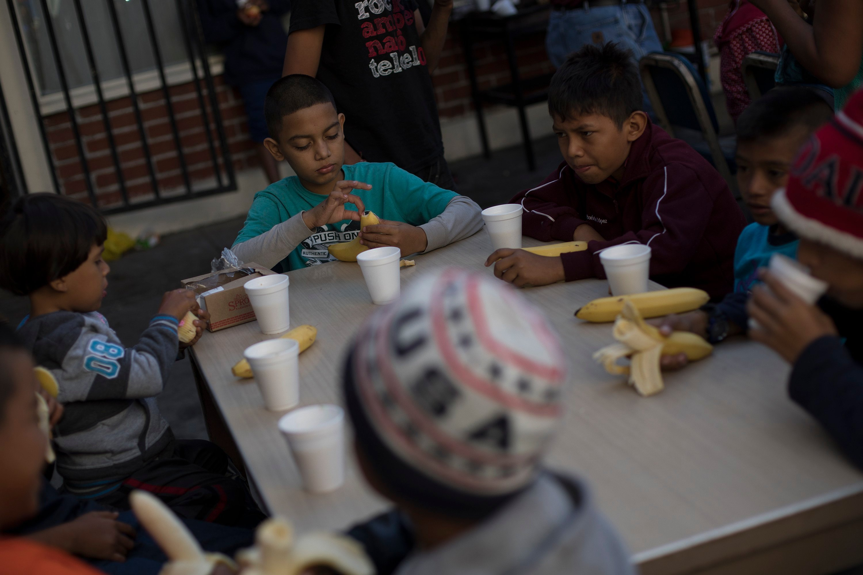 "Children have their breakfast at the ""Vina de Tijuana AC"" migrant shelter in Tijuana, Mexico, Saturday, April 28, 2018. (Source: AP Photo/Hans-Maximo Musielik)"