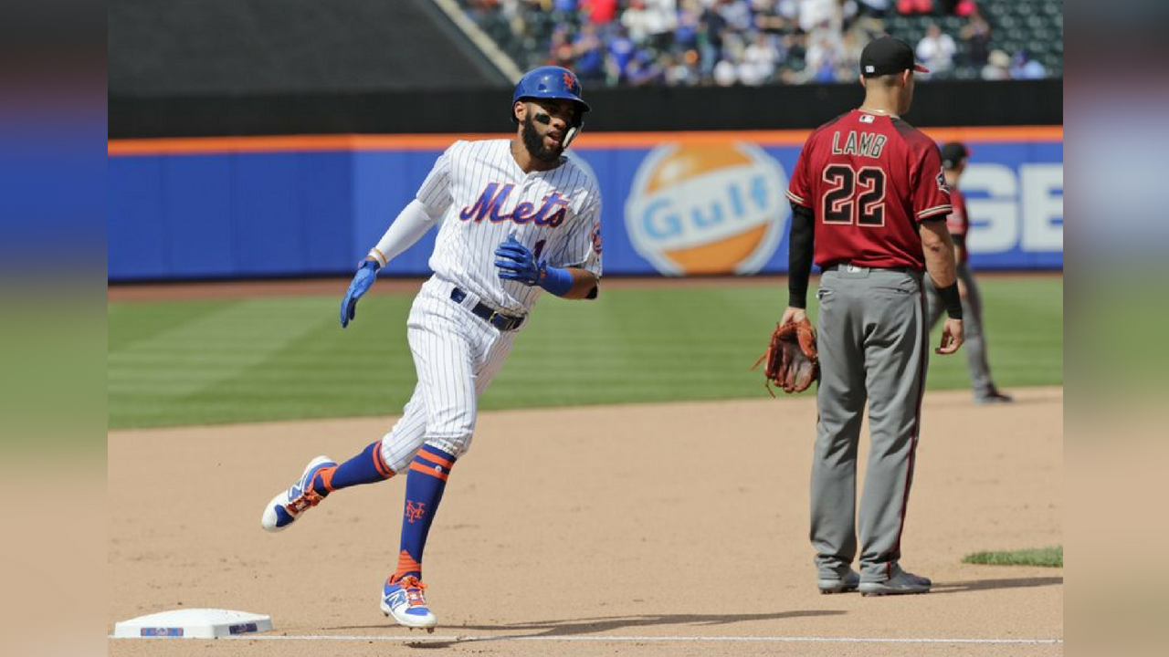 New York Mets' Amed Rosario (1) runs the bases after hitting a home run during the seventh inning of a baseball game as Arizona Diamondbacks third baseman Jake Lamb (22) looks away Sunday, May 20, 2018, in New York. (Source: AP Photo/Frank Franklin II)