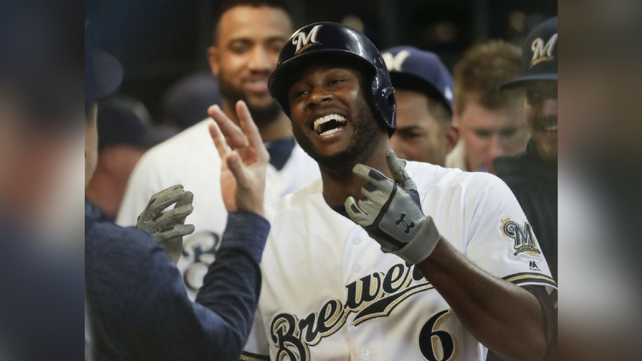 Milwaukee Brewers' Lorenzo Cain celebrates after hitting a home run during the sixth inning of a baseball game against the Arizona Diamondbacks Monday, May 21, 2018, in Milwaukee. (Source: AP Photo/Morry Gash)