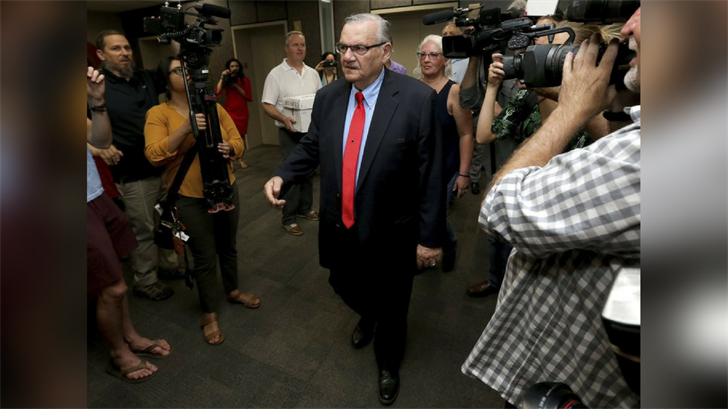 Former Arizona Sheriff Joe Arpaio arrives Tuesday at the Arizona Secretary of State's office in Phoenix to turn in petition signatures in his bid to appear on the ballot in the race to succeed retiring U.S. Sen. Jeff Flake. (Source: AP Photo/Matt York)