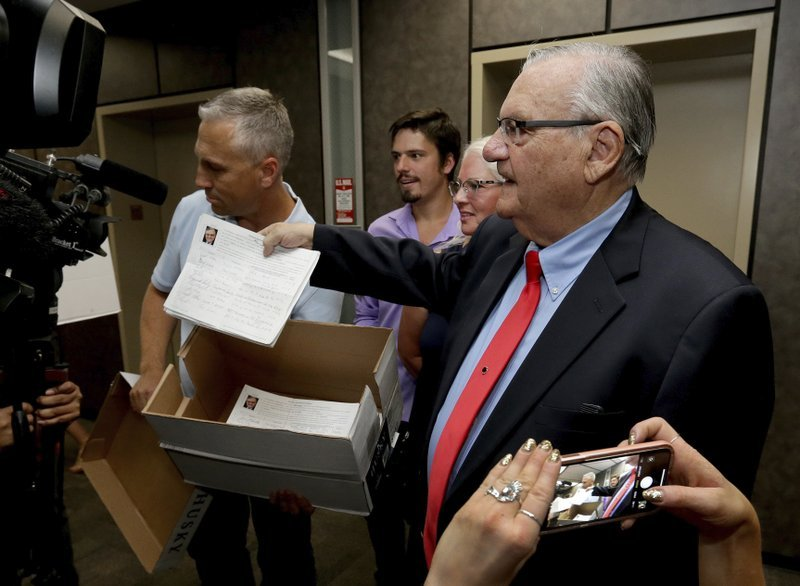 The Republican lawman's campaign says it turned in 10,000 signatures on Tuesday so he can compete in the GOP primary on Aug. 28. (Source: AP Photo/Matt York)