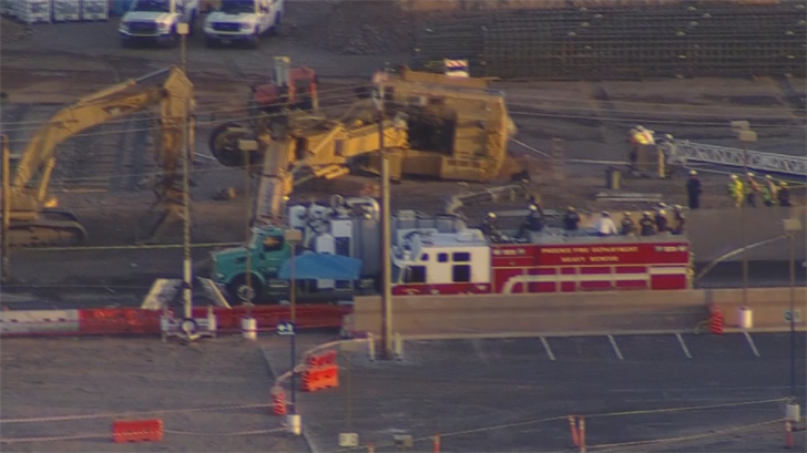 The search and rescue teams are using a vacuum truck to remove dirt to get to the missing construction worker. (Source: 3TV/CBS 5)