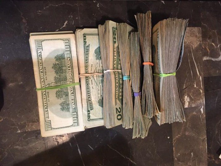 Detectives seized $10,000 in cash. (Source: MCSO)