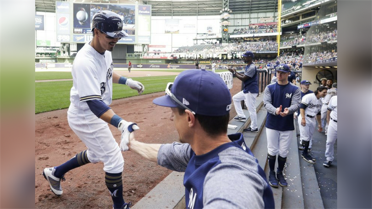 Milwaukee Brewers manager Craig Counsell congratulates Tyler Saladino after his home run during the seventh inning of a baseball game against the Arizona Diamondbacks Wednesday, May 23, 2018, in Milwaukee. (Source: AP Photo/Morry Gash)