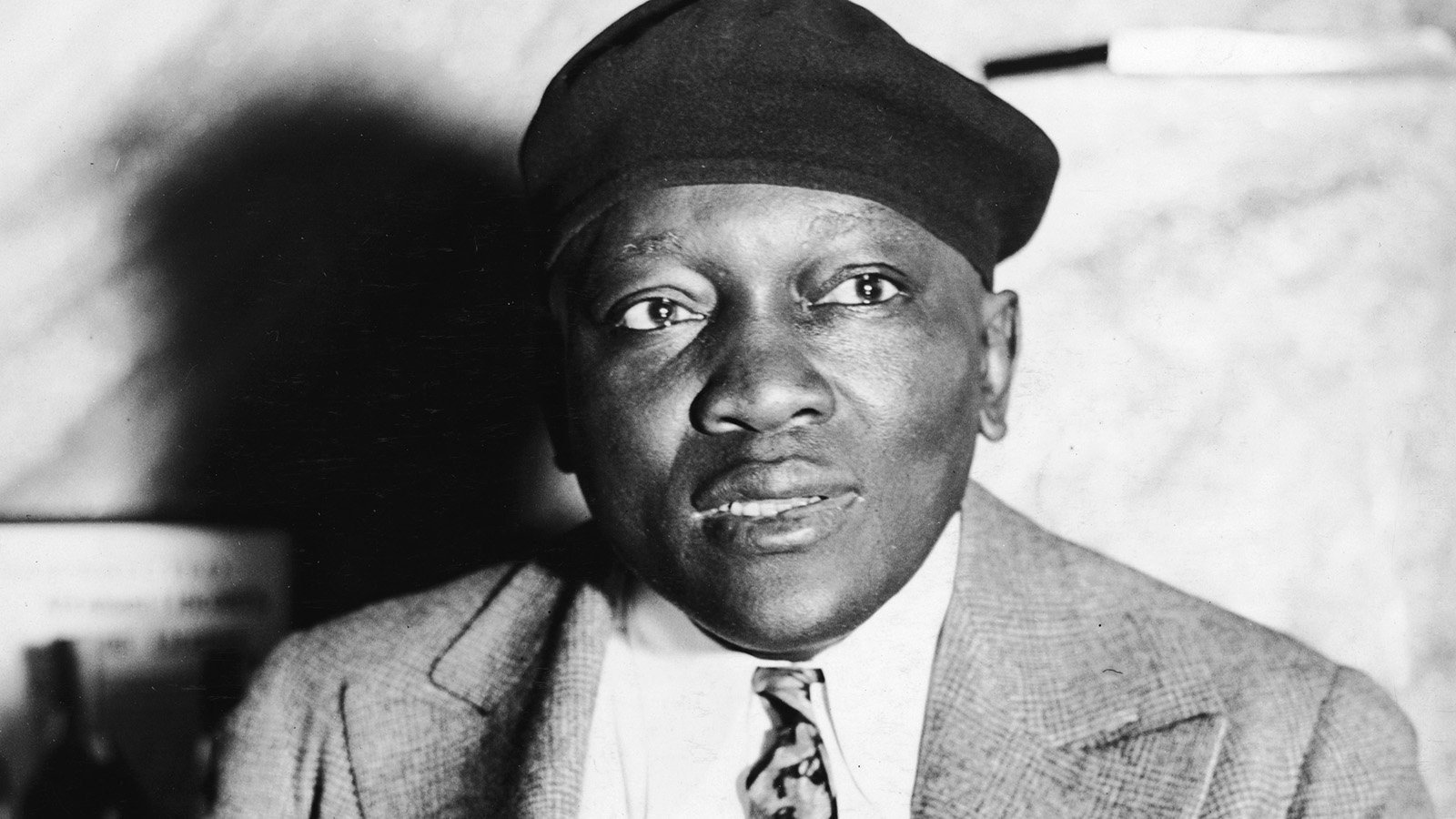 Portrait of American boxer, heavyweight champion and inventor Jack Johnson (1878 - 1946) smoking a cigar, circa 1930s. (Source: LASS/Hulton Archives/Getty Image)