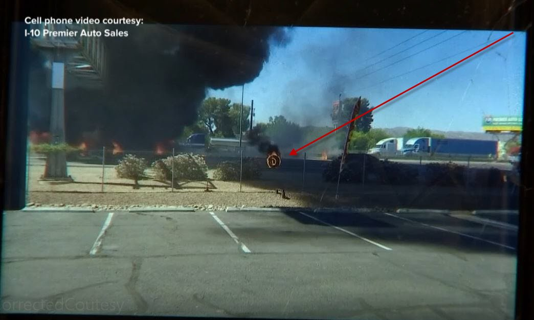 Employees at a nearby business saw a flaming tire roll away from the burning semi. (Source: I-10 Premier Auto Sales)