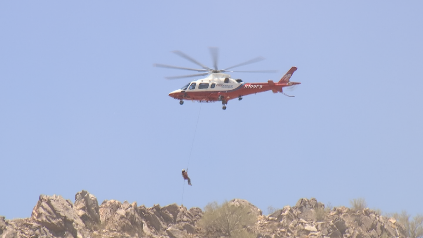 Firefighters used their helicopter to rescue a woman off of Camelback Mountain. (Source: 3TV/CBS 5)