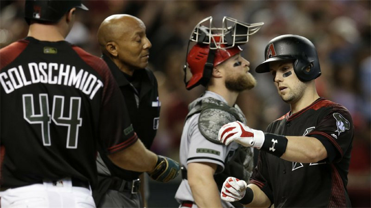 Arizona Diamondbacks' Chris Owings celebrates with Paul Goldschmidt (44) after hitting a three-run home run in the fifth inning during a baseball game against the Cincinnati Reds, Monday, May 28, 2018, in Phoenix. (Source: AP Photo/Rick Scuteri)