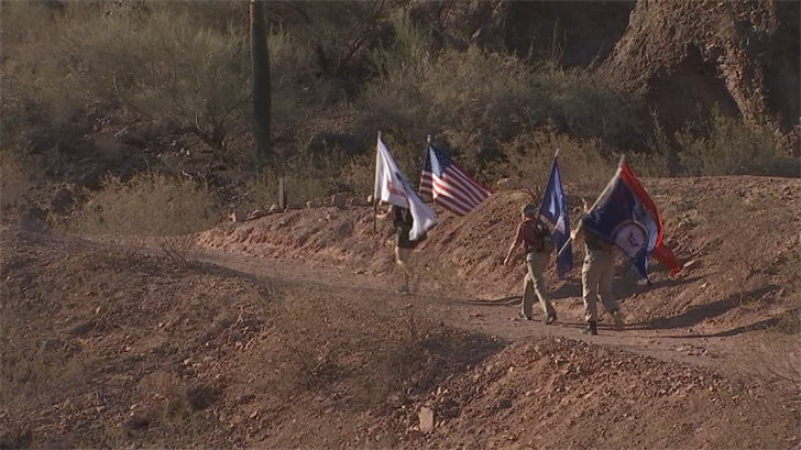 A group of veterans carried military flags and the U.S. flag up Camelback Mountain. (Source: 3TV/CBS 5)