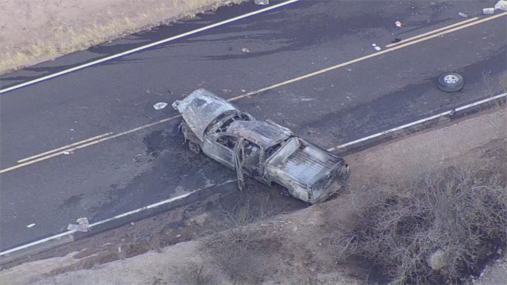 The vehicle rolled several times, catching fire on Bush Highway near Saguaro Lake. (Source: 3TV/CBS 5)