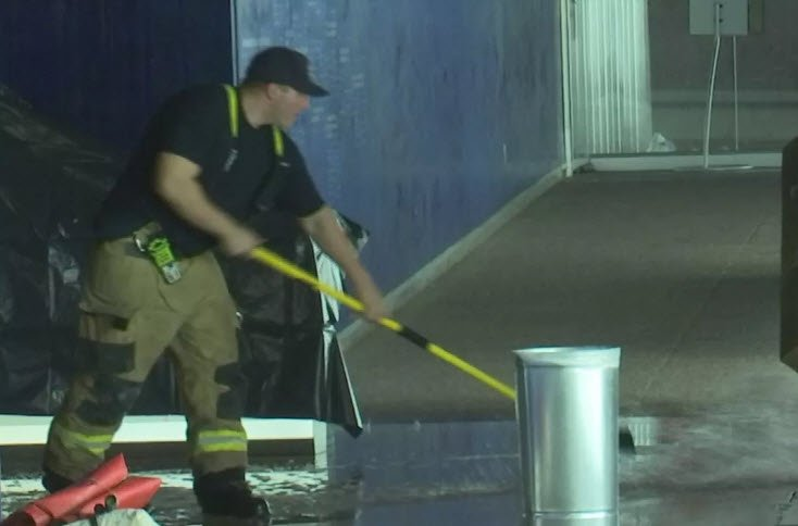 Mopping up after heavy monsoon damage at the library (Source: Phoenix Fire Dept.)