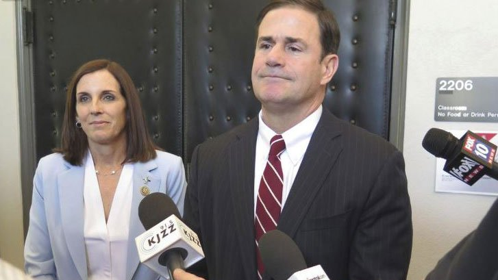 In this Wednesday, May 30, 2018, photo, U.S. Rep. Martha McSally and Arizona Gov. Doug Ducey speak to reporters in phoenix, Ariz., following testimony in a field Congressional hearing on opioid abuse and the border. (Source: AP Photo/Astrid Galvan)