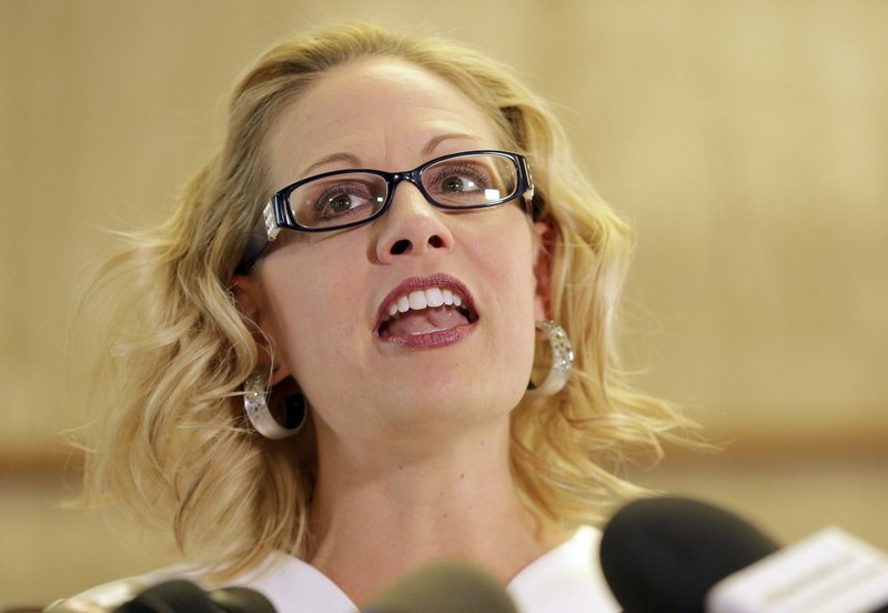 U.S. Rep. Kyrsten Sinema, D-Ariz. speaks prior to delivering her signatures to the Arizona Secretary of State's office Tuesday, May 29, 2018 at the Capitol in Phoenix. (Source: AP Photo/Matt York)